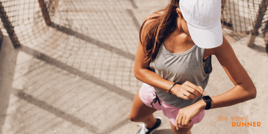 best running watches women looking down at running watch