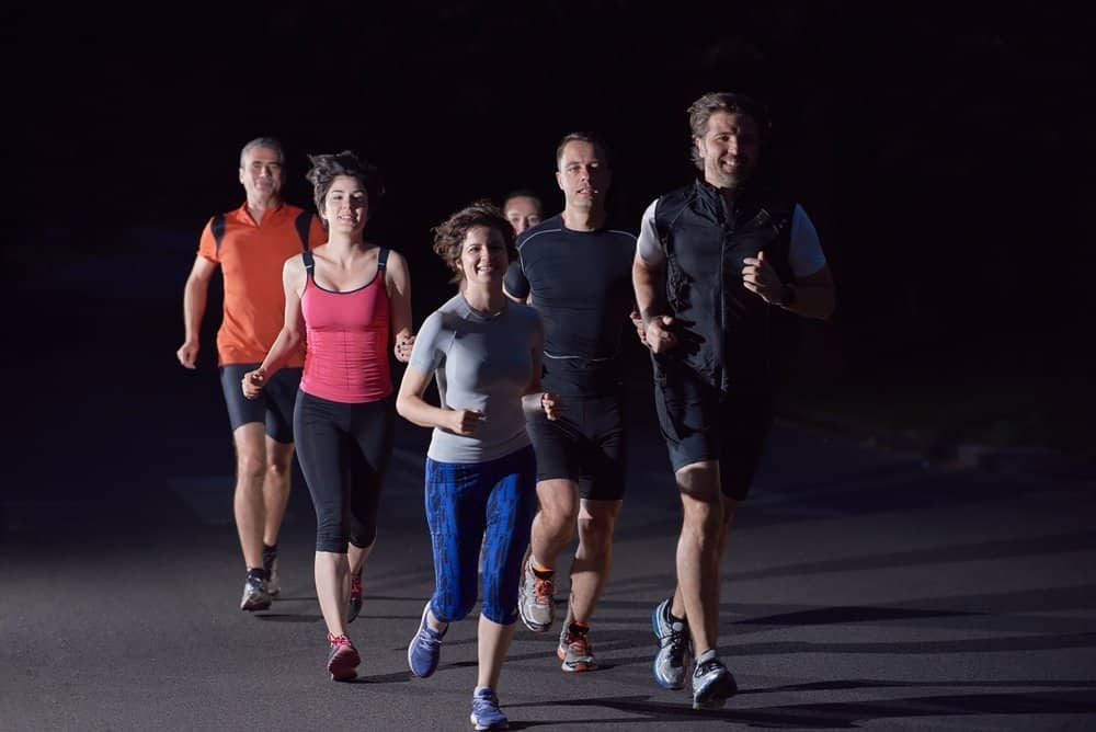 running at night in group