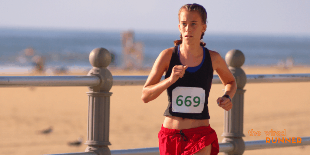 women running in 5k on beach
