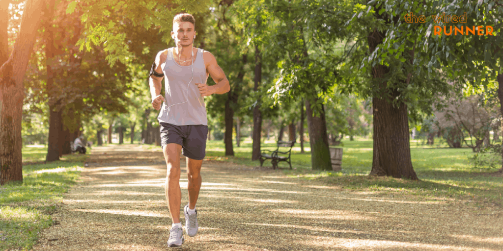 man doing recovery run in park