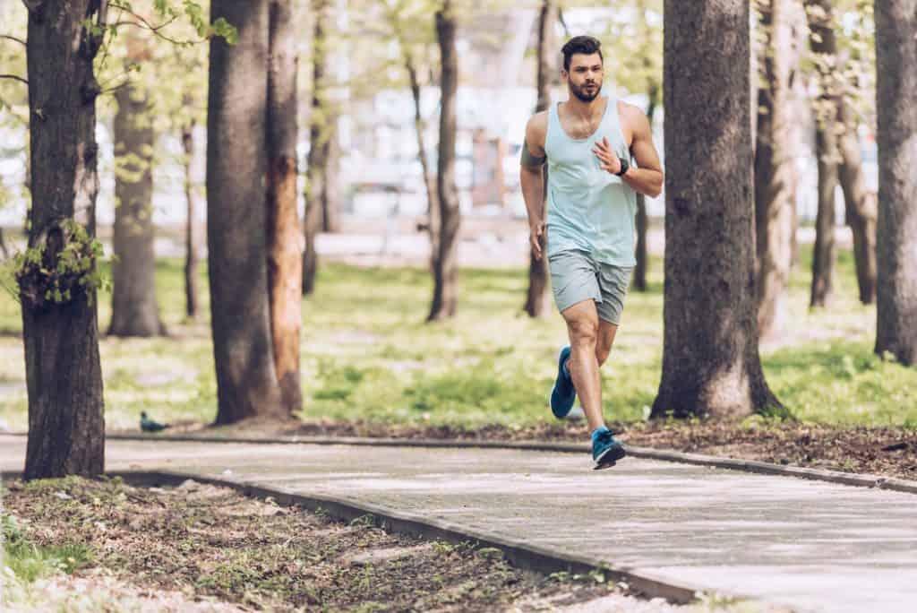 man running in park fartlek workout