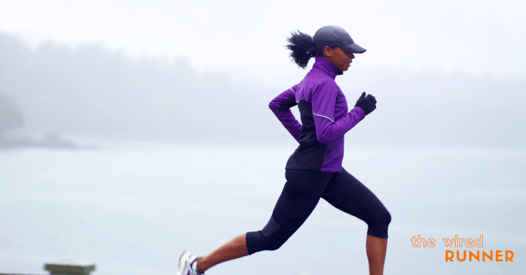 women running alone by water
